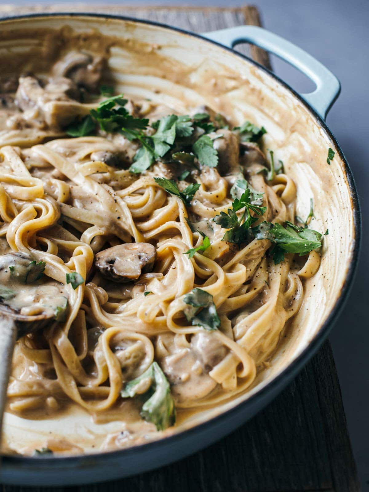 Pasta and mushroom sauce in a pot.