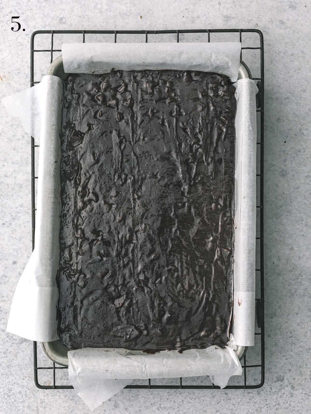 Unbaked brownie in a baking tray.