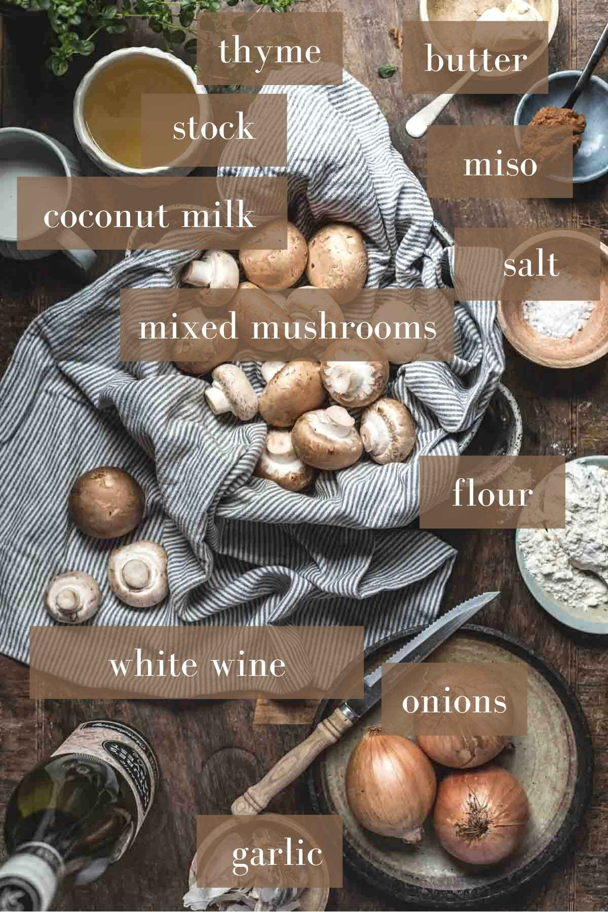 Mushroom soup ingredients on a wooden board with labels.