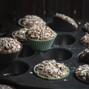 Zucchini muffins in a baking tray.