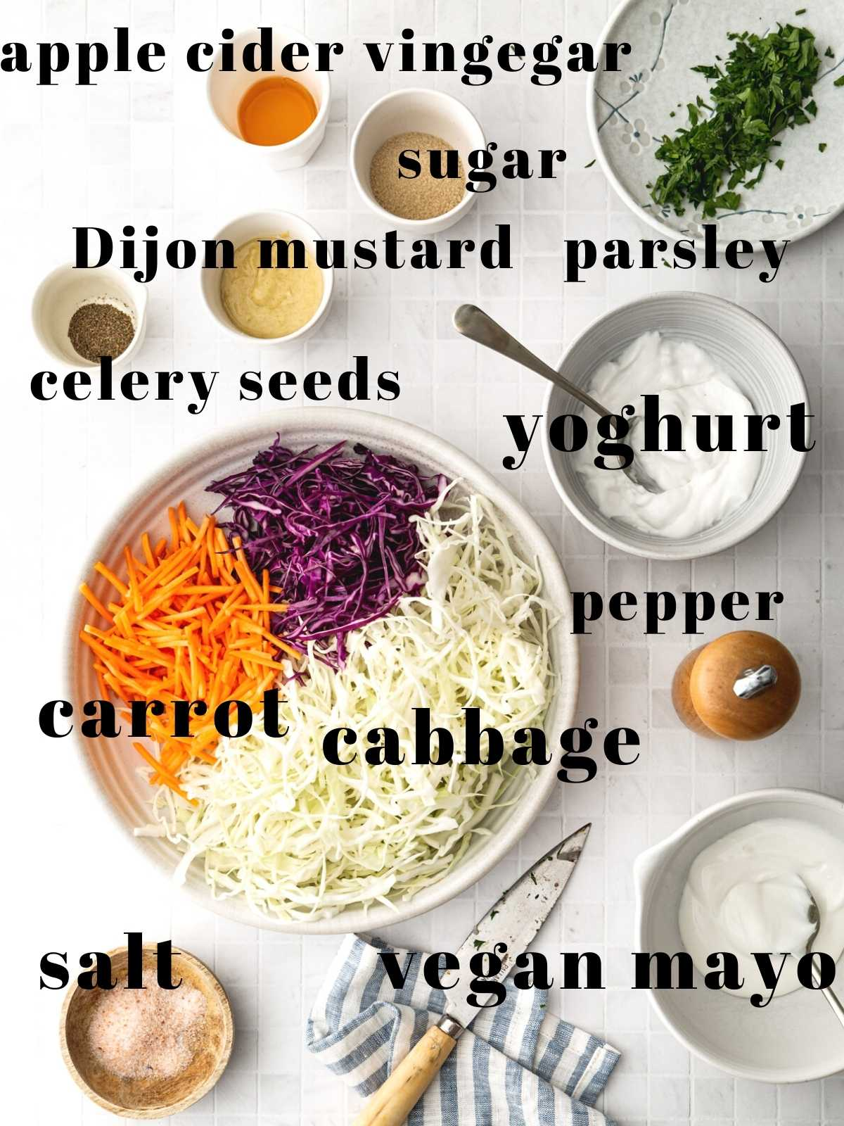 Labelled bowls of ingredients for a vegan coleslaw.
