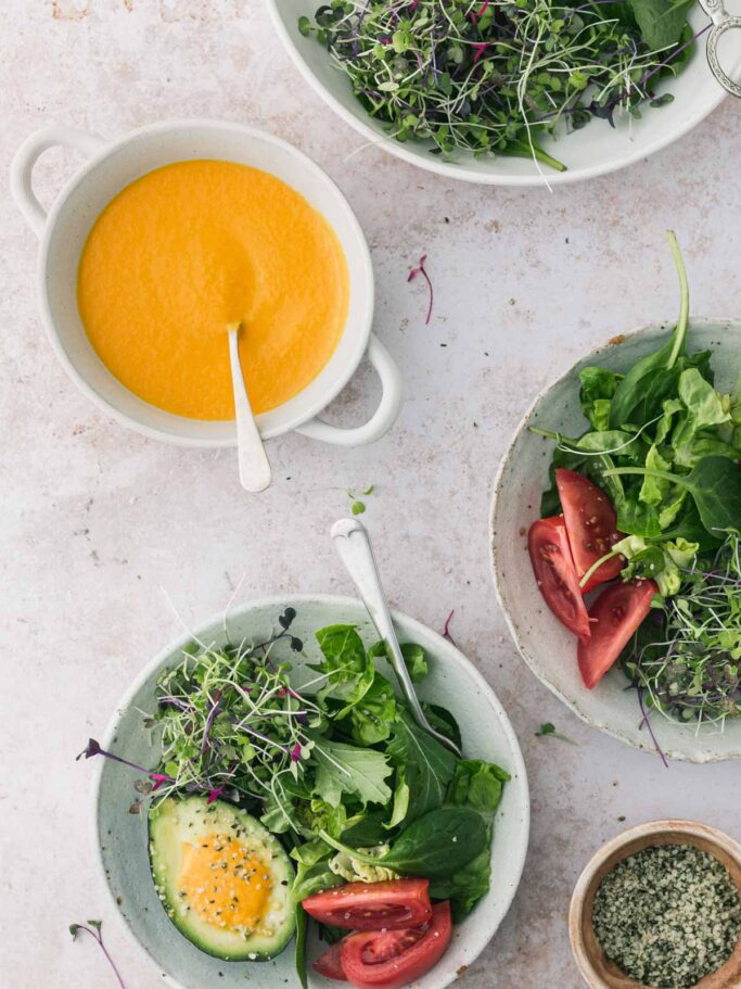 Bowls of salad with dressing.