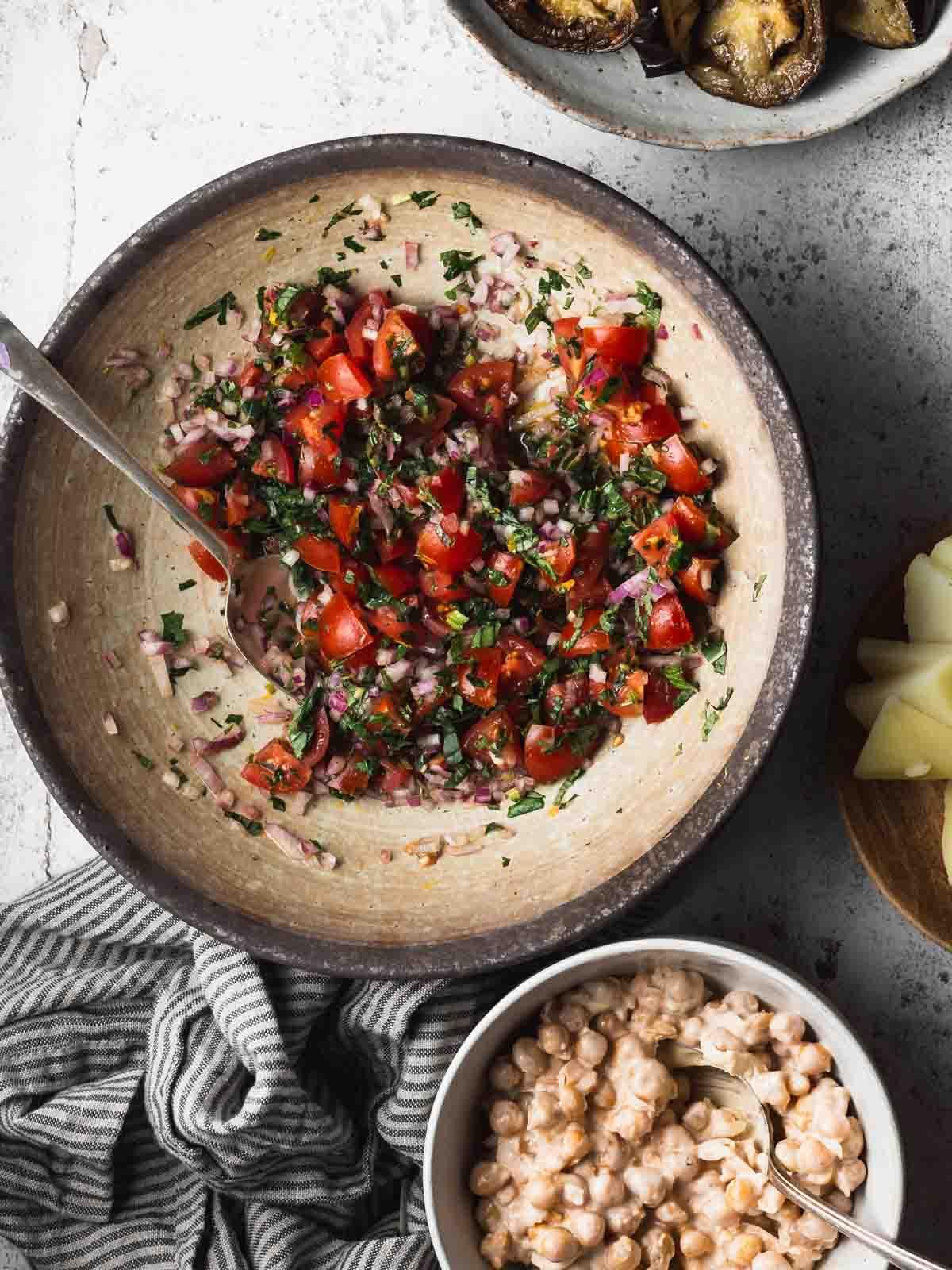 A bowl of chopped tomato salad.