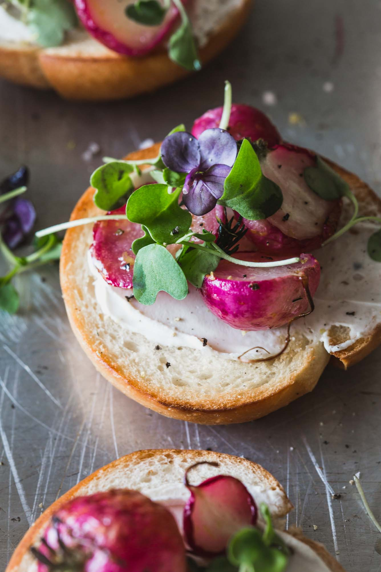Radishes on a mini bagel with micro greens.