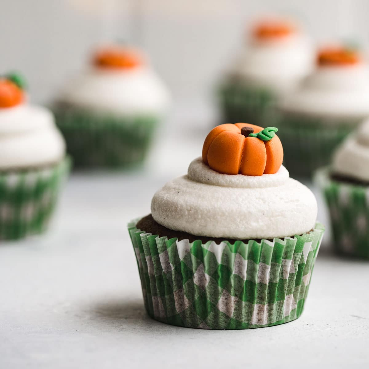 A cupcake with a pumpkin topper.